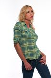 Green plaid. Pretty young blonde woman in a green plaid shirt and jeans Stock Photo