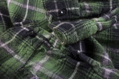 Green plaid flannel fabric cloth. Tartan garment textile Royalty Free Stock Photo