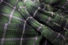 Green plaid flannel fabric cloth. Tartan garment textile Royalty Free Stock Image