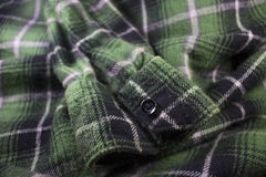 Green plaid flannel fabric cloth. Tartan garment textile Royalty Free Stock Images