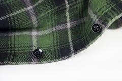 Green plaid flannel fabric cloth. Tartan garment textile Stock Photography