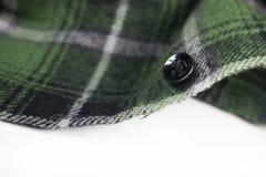 Green plaid flannel fabric cloth. Tartan garment textile Stock Images
