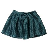 Green plaid mini skirt Stock Photography