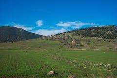 Green plains and mountains around Vitina, Peloponnese, Greece Stock Image