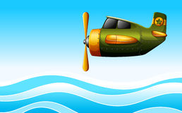 A green plane above the ocean Royalty Free Stock Photo