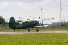 The green An-2 plane on a runway. Stock Photo