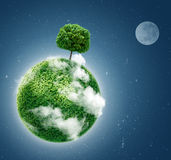 Green planet on blue Stock Image