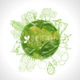 Green planet with circle ecology doodles. Sketched eco elements with earth and leaves Royalty Free Stock Photo