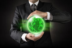 Green planet Earth in Businessman hands Stock Photo