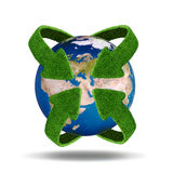 Green planet. Ecology concept. Concept with green arrows from the grass. Recycling concept Stock Photos