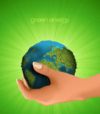 Green Planet in hand Stock Photo