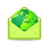 Green planet inside envelope. Terrestrial globe inside green envelope over white Royalty Free Stock Images