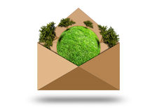 Green planet with trees in an envelope Royalty Free Stock Image