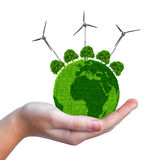 Green planet with trees and wind turbines in hand Stock Photography