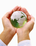 Green planet in women's hands. Stock Image