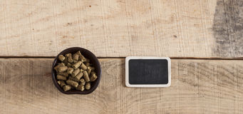 Green plant hops on old wood table Royalty Free Stock Images