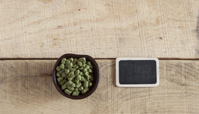Green plant hops on old wood table Royalty Free Stock Image