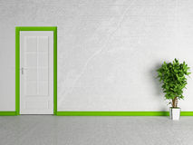 Green plant near the white door Stock Image