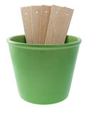 Green plant pot with wooden labels Stock Images