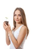 Green plant sprout in female hand Stock Images