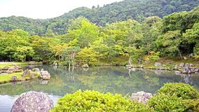 Green plants, trees, mountain, lake with reflection in Japan zen. The green plants, trees, mountain, lake with reflection in the Japan zen garden stock image