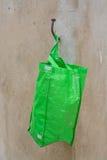 Green plastic bag Stock Images