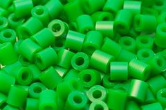 Green plastic beads. Group of green plastic beads Stock Photography