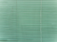 Green plastic blinds. Royalty Free Stock Images