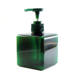 Green plastic bottle with dispenser pump Stock Images