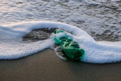 Free Green Plastic Bottle On Ocean Sea Water Foam,ecosystem Pollution Free Concept Stock Images - 165601754
