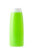 Green plastic bottle for shampoo. Standing on a white Royalty Free Stock Image