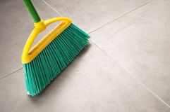 Green plastic broom Stock Image