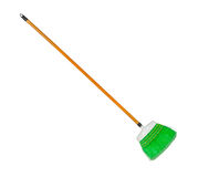 Green plastic broom with log brown handle Stock Images