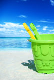 Green plastic bucket on the beach Royalty Free Stock Photos