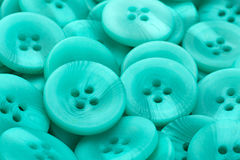 Green plastic button background Stock Photo
