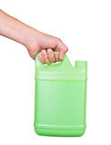 Green plastic canister in hand Royalty Free Stock Images