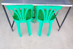Green plastic chair Stock Images