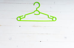 Green plastic clothes hanger Stock Photography