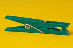 Green plastic clothespin Stock Image