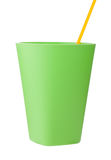 Green plastic cup with straw isolated on white. 