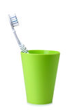 Green plastic Cup with toothbrush Stock Photo