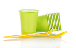 Green plastic cups and yellow fork isolated on white Royalty Free Stock Images