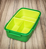 Green plastic food box, kitchen utensil Royalty Free Stock Photo
