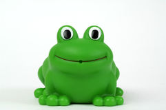 Green plastic frog. Green plastic toy frog on white background Royalty Free Stock Image