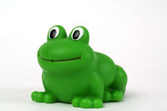 Green plastic frog. Green plastic toy frog on white background Stock Photography