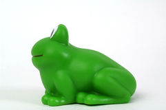 Green plastic frog. Green plastic toy frog on white background Stock Images