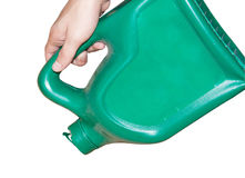 Green plastic fuel. Hand holding a oil cans with the loss Stock Photos