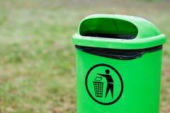 Green plastic garbage bin Stock Image