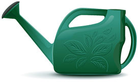 Green plastic garden watering can Royalty Free Stock Images
