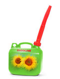 Green plastic gas can (fuel container). Green plastic gas can (fuel container) with sunflowers. Environmental concept. Natural gas metaphor stock image